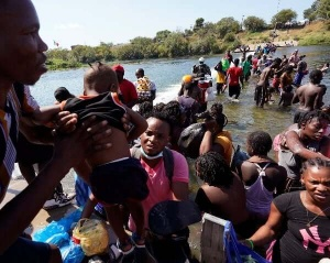 Report Admin, Under Fire, Will Fly 'Massive' Number of Haitians to Haiti
